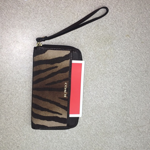 Coach Handbags - COACH zebra wristlet MINT CONDITION box included